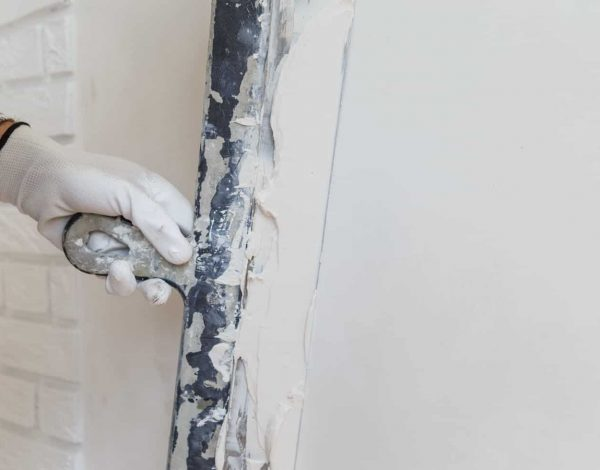 worker-in-white-gloves-performs-plastering-of-the--KJ95T87